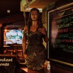 Carved wooden mermaid figurehead and weekly menu