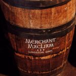 wooden barrel with iron straps & stencil that reads 'Merchant MacLiam, Kingston ONT'